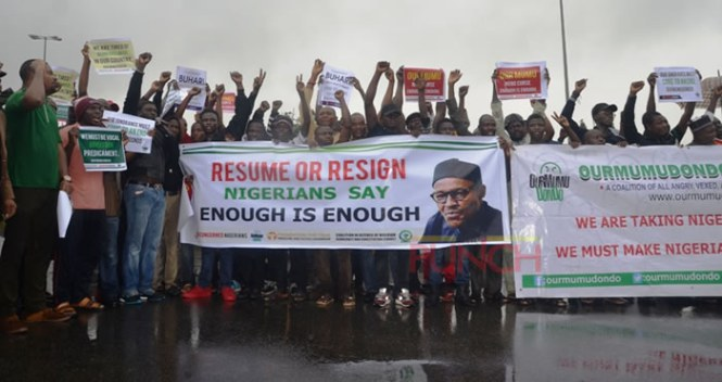 BREAKING: #ResumeOrResign protesters, Charley Boy attacked in Abuja's Wuse market (Photos)