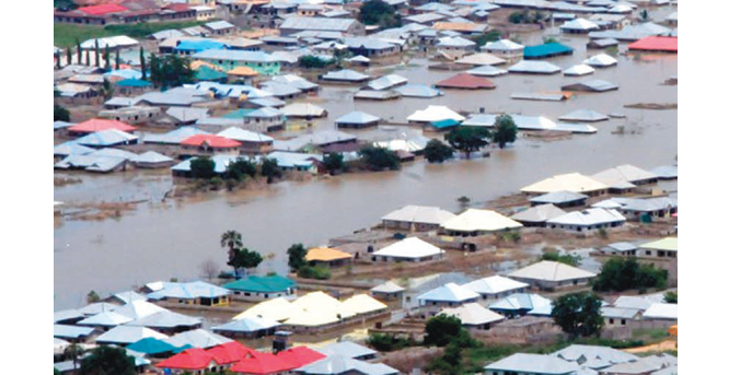 PHOTO: 20 Houses, Six communities affected as Flood submerges over 20, 000 Hectares of farmlands in Edo