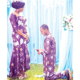 Husband kneels before wife to renew vows